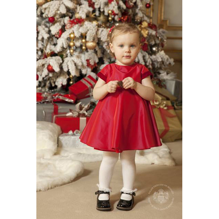 Gabriella looked festive in a red dress and matching bows for her 2016 Christmas photos.
