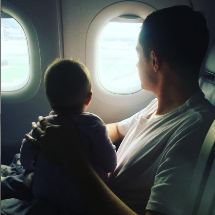 Nicky Hilton and James Rothschild's daughter Lily Grace made her social media debut just in time for the holidays. In the photo, the little lady, who was born July 8, is looking out the window of an airplane as she sits on her daddy's lap. 