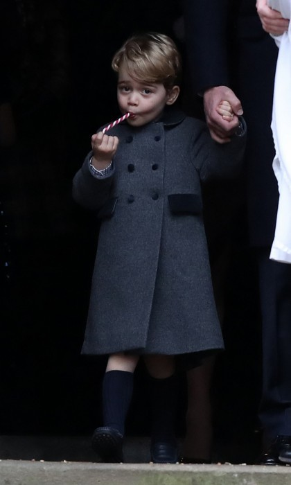 Prince George enjoyed a Christmas treat as he left St. Mark's Church in Englefield, Berkshire with his family.