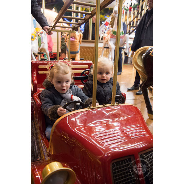 Princess Gabriella took the wheel as she rode on a carousel with her brother Prince Jacques during their visit to Monaco's Christmas Village.