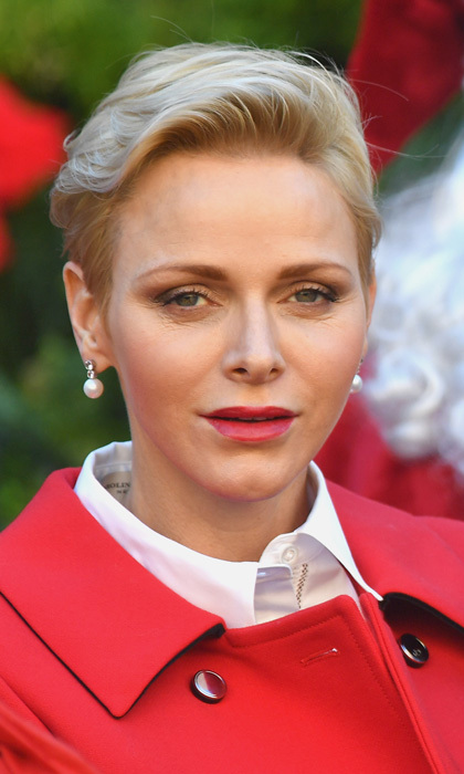Princess Charlene of Monaco was holiday ready rocking a bold red lip at the annual Christmas gifts distribution ceremony.