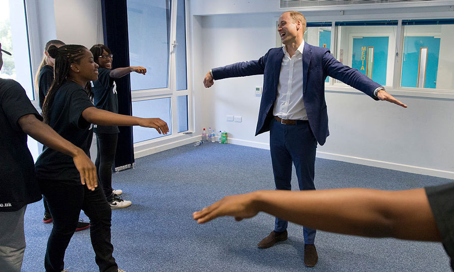 Prince William laughed at his attempt to dance during an outing to Battersea's Caius House to see how hundreds of people benefit from the youth center's services each week.