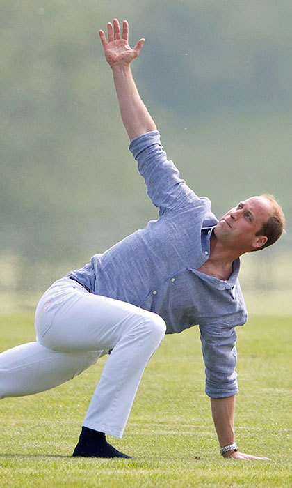 Prince William showed off impressive yoga skills while stretching before a charity polo match.