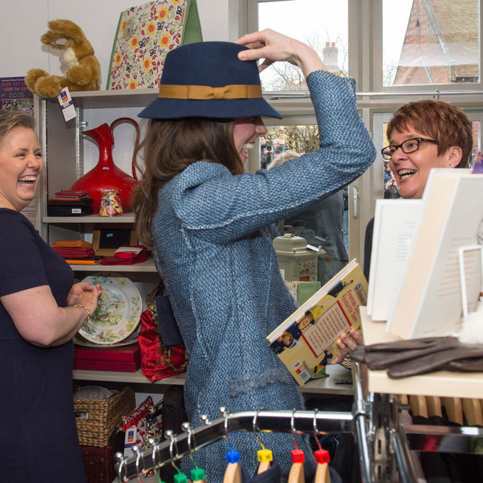 Kate had fun trying on hats, while touring a new EACH charity shop inHolt, United Kingdom. 