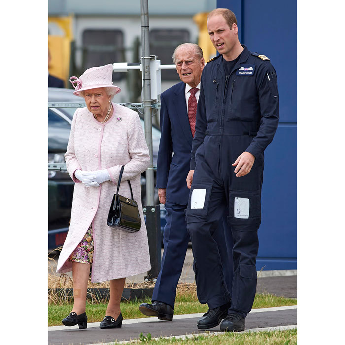 William gave his grandparents, Queen Elizabeth II and the Duke of Edinburgh, a tour of the new East Anglian Air Ambulance base at Cambridge Airport.