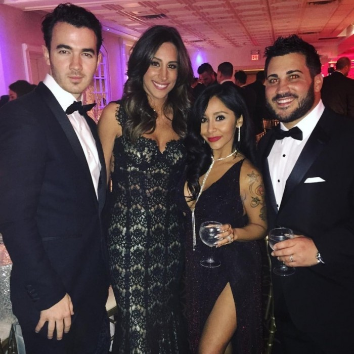 Jersey pride! Snooki shared a shot of her and husband, Jionni LaValle, with Kevin and Danielle Jonas. The stars celebrated NYE at celebrity trainer Anthony Michael's wedding.