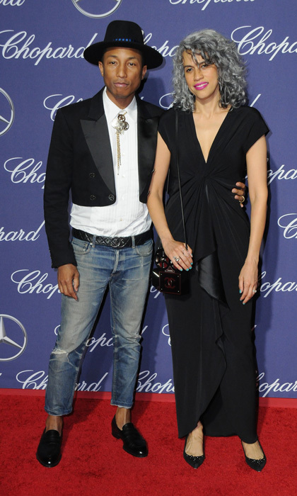 January 2: Pharrell Williams opted for denim and a cropped black jacket paired with his signature hat alongside his producing partner, Mimi Valdés at the Palm Spring Film Fetsival Awards sponsored by Mercedes-Benz.