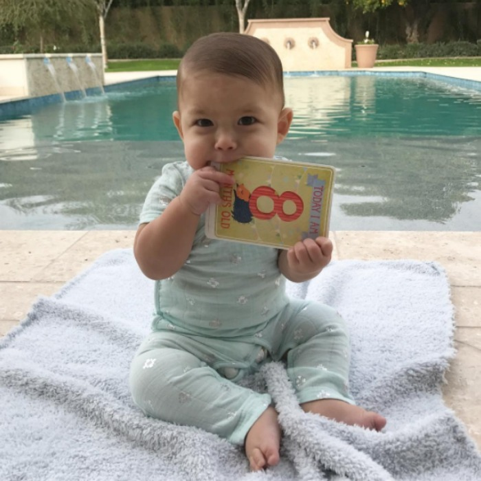 "Eight-months of cuteness! Nicole Phelps celebrated her baby boy's latest milestone with a poolside photo. Boomer looked dapper with his hair parted to one side as he posed for his mom. Attached to the photo, Michael Phelps' wife wrote, ""Boomer already has opinions about turning another month old #8months @milestonebaby @adenandanais."" 