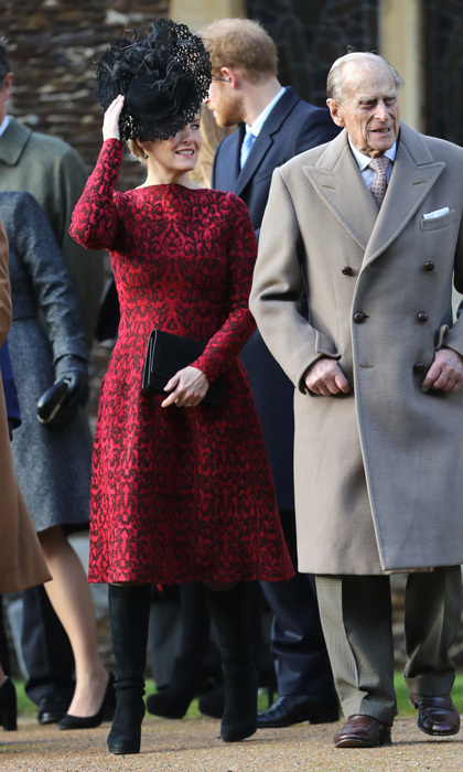 Sophie Wessex looked festive on Christmas sporting a red dress, which she paired with black suede boots and an elaborate black headpiece for church at Sandringham with the British royal family.