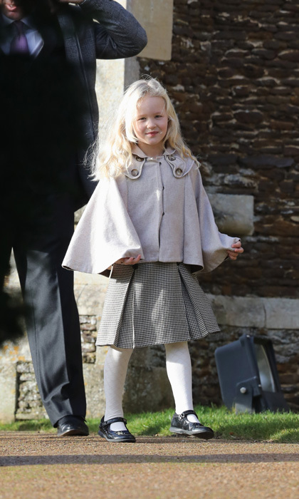 Savannah Phillips proved to be a young royal fashionista in the making wearing a tweed skirt and cape coat for Christmas church service with her extended family in Sandringham.