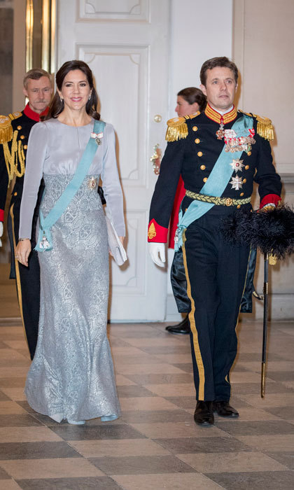 Crown Princess Mary wowed in a periwinkle gown alongside her husband, Crown Prince Frederik, at a New Year reception for the diplomatic Corps at Christiansborg Palace. 