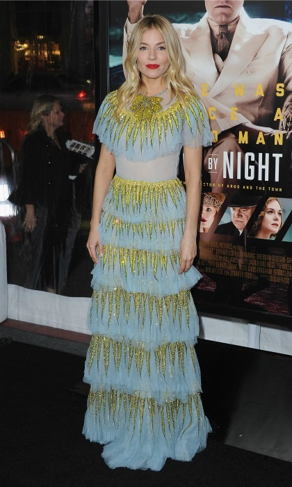 January 9: Sienna Miller turned heads wearing a tiered Gucci frock to the premiere of <i>Live by Night</i> in Hollywood. 