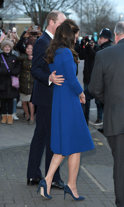 The couple showed a moment of public affection as they left the Child Bereavement UK Centre. William placed his hand on his wife's back as they made their way to their car.