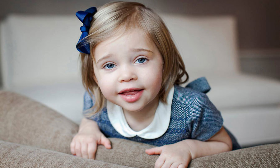 Leonore flashed her baby blue eyes in a sweet portrait for her second birthday.