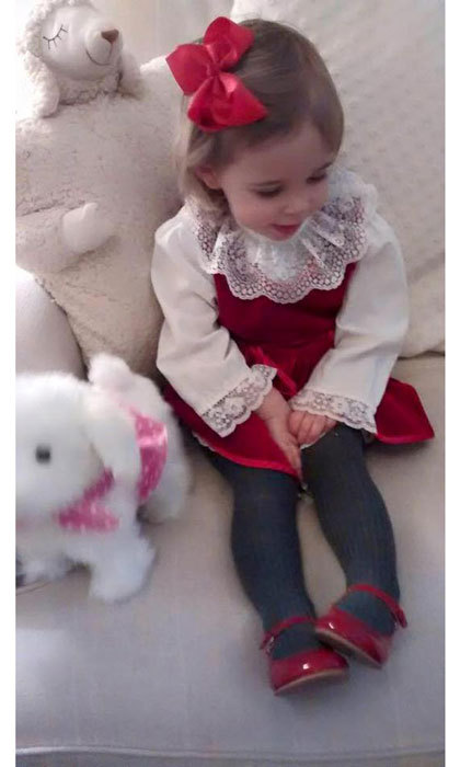 "Leonore looked like a little doll wearing her mom's ""old dress"" for Christmas 2015.