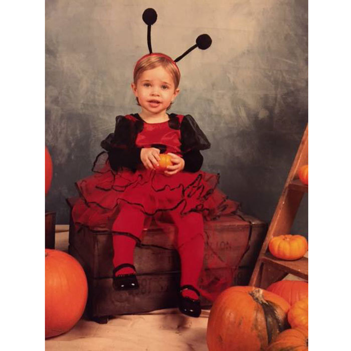 Leonore looked cute as a bug posing for a Halloween portrait in her ladybug costume.