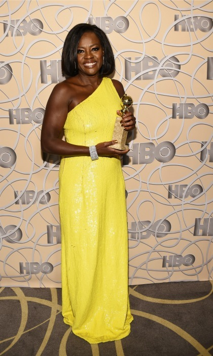 Not only did Viola Davis win for her role in <i>Fences</i> at the 2017 Golden Globes, but also for her stand-out yellow off-the-shoulder gown by Michael Kors. 