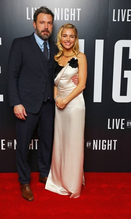 January 11: Sienna Miller snuggled close to co-star Ben Affleck in a dress by Lanvin during the <i>Live by Night</i> premiere in London. 