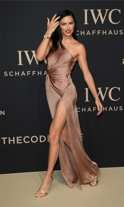 "January 17: A lot of leg and a lot of style! Adriana Lima wore a sleek gold dress by Cushnie et Ochs and shoes by Giuseppe Zanotti during the IWC Schaffhausen at SIHH 2017 ""Decoding the Beauty of Time"" gala dinner in Geneva, Switzerland. 