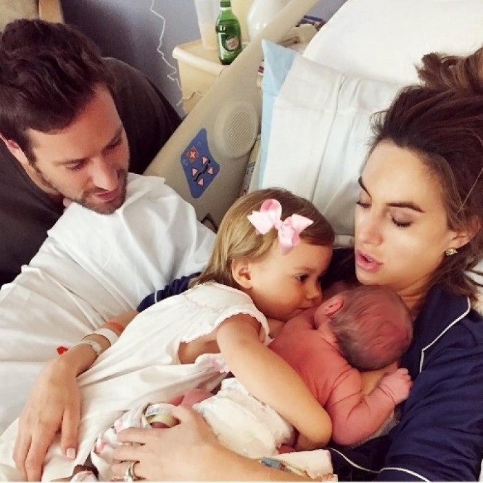 "Armie and Elizabeth Hammer first showed off their baby boy during another cuddle session with Harper. The mom-of-two wrote: ""Beyond grateful for the prayers and for this ultimate blessing. We couldn't be more in love.""