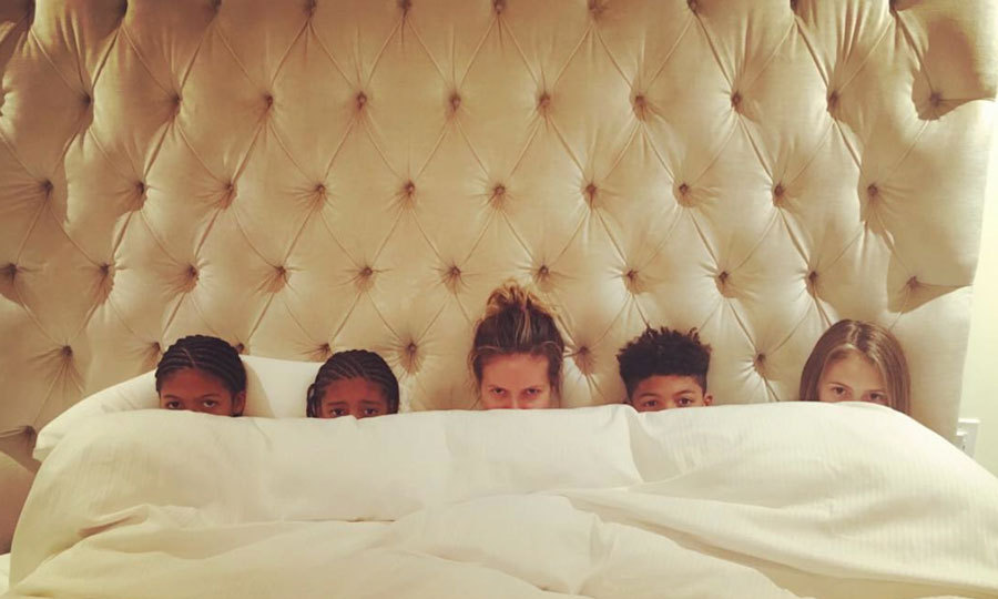 """Heidi Klum looked snug as a bug in bed with her children, Helene, Henry, Johan and Lou. """"Bed time. ZzzzZzzzZzzzz,"""" the model captioned the family photo. Photo: Instagram/@heidiklum"""