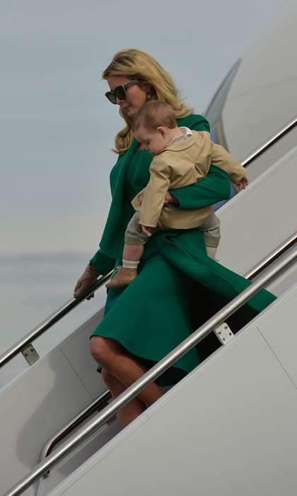 Ivanka Trump looked characteristically chic as she disembarked Air Force One carrying her son Theodore Kushner.