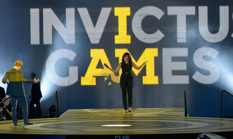 "Never letting their competitive edge get in the way of their friendship, Michelle greeted Harry on stage during the opening ceremony of the 2016 Invictus Games. The first lady praised Harry for all his hard work, telling the crowd ""He is truly our Prince Charming isn't he? He should be proud of himself for his work.""