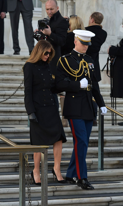 Melania was escorted down stairs by a solider at Arlington National Cemetery in Arlington, Virginia.