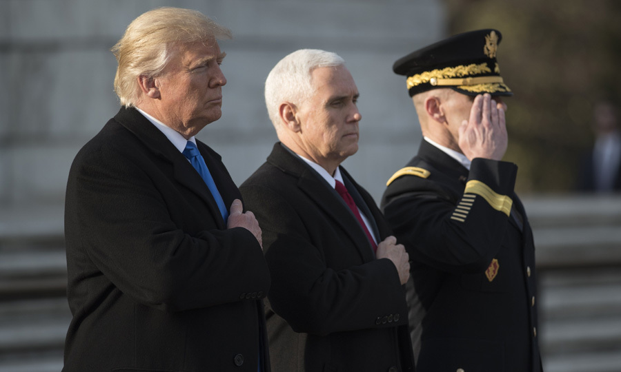 The president-elect and vice president-elect paid their respects after laying a wreath at Arlington National Cemetery.