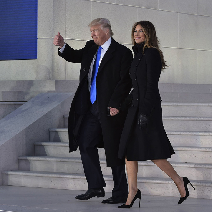 The president-elect threw up his signature thumbs up as he and his wife Melania made their way to their seats to join their family at the inauguration concert.