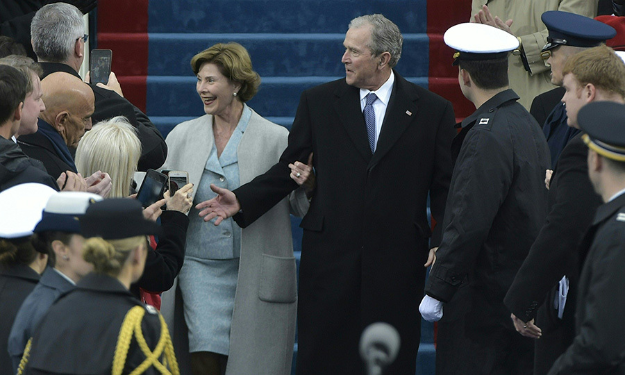 Former First Lady Laura Bush opted for a shade similar to Melania Trump's as she arrived to the ceremony with her husband former President George W Bush. The ex-president's parents, ex-President George HW Bush and wife Barbara Bush were unable to attend to do poor health. 