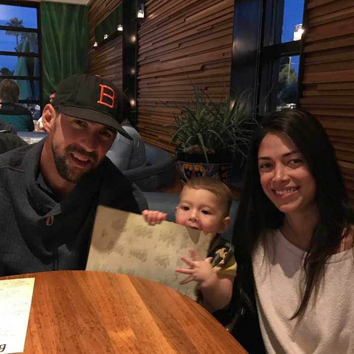 "Boomer Phelps is a big boy! Proud dad Michael Phelps shared a photo of his and wife Nicole's son out at a restaurant, which he captioned, ""@boomerrphelps first high chair experience last night!! He's growing up sooooo fast!!!!""