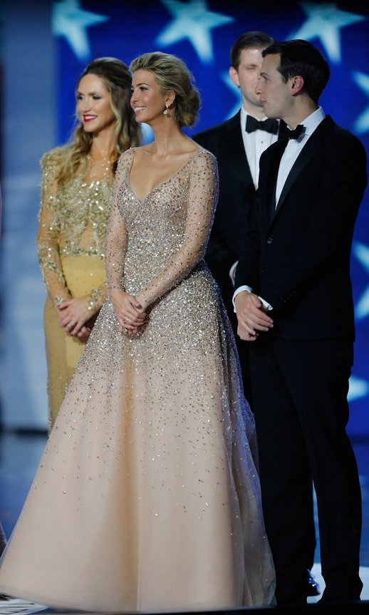 Ivanka, with sister-in-law Lara, brother Eric and husband Jared, was one of the night's belles of the balls in a sparkling champagne dress by Carolina Herrera. 