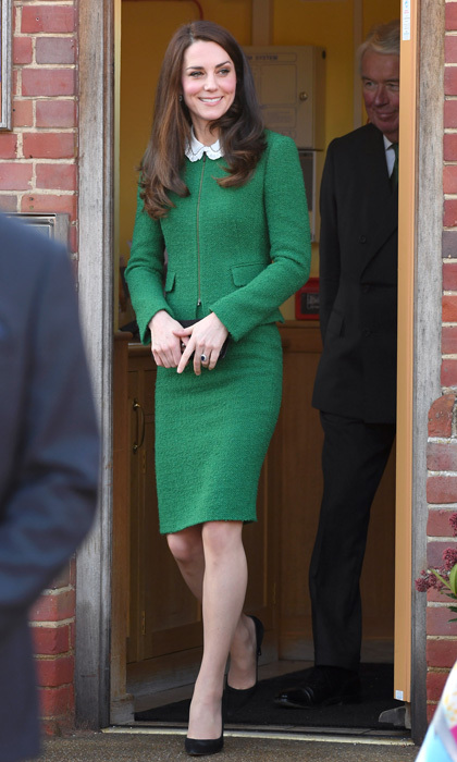 The Duchess of Cambridge was a vision in green stepping out for the outing wearing a collarless jacket and skirt by Hobbs London, which she paired with a Gerard Darel Josephine blouse, black suede Gianvito Rossi pumps and her trusty Mulberry clutch.