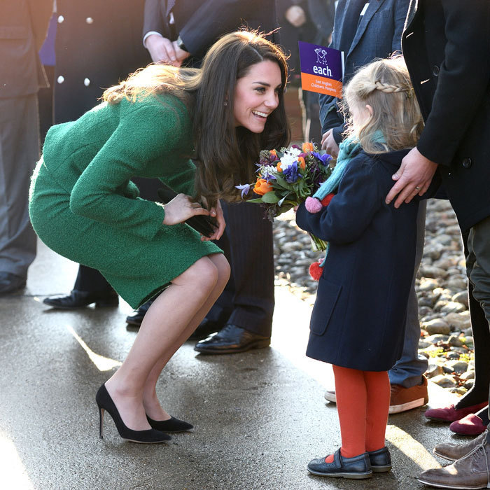 The Duchess of Cambridge was presented with flowers upon her arrival to East Anglia's Children's Hospices facilities in Quidenham by Nell Cork, whose brother Finnbar died at age five.