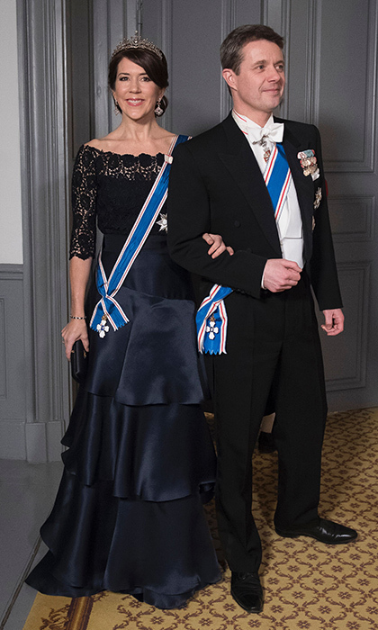 Wearing a tiara and tiered silk skirt, Crown Princess Mary of Denmark was escorted by husband Crown Prince Frederik to the gala dinner for Iceland's President at Amalienbog Castle in Copenhagen on January 24.