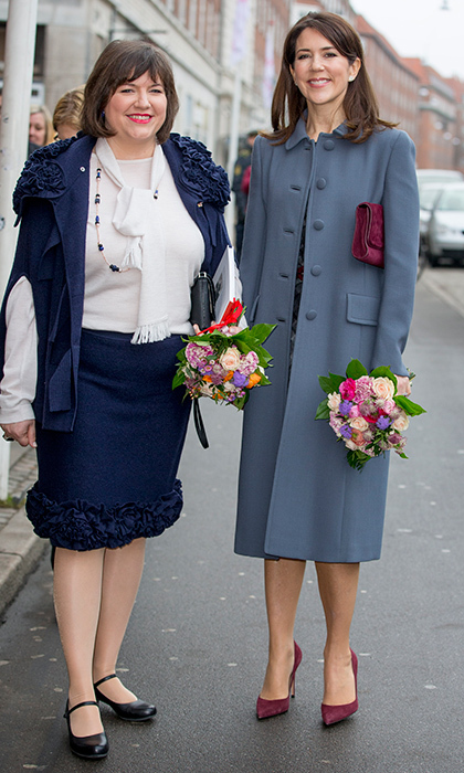 Crown Princess Mary of Denmark, right, gave her blue coat a pop of color with burgundy accessories when she met with Iceland's First Lady Eliza Reid on January 25 in Copenhagen.