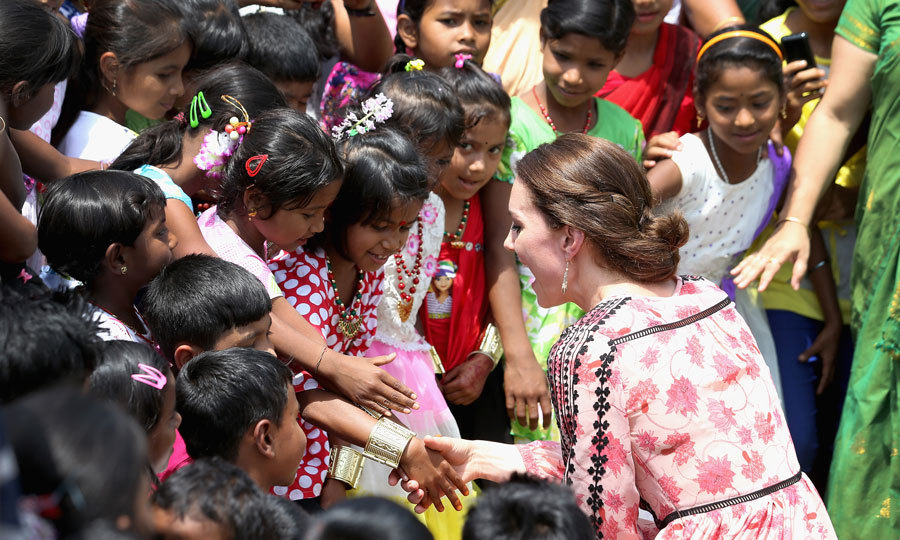 The Duke of Cambridge's wife shook hands with young kids while visiting the Pan Bari agricultural village in Kaziranga National Park during her royal tour of India and Bhutan.