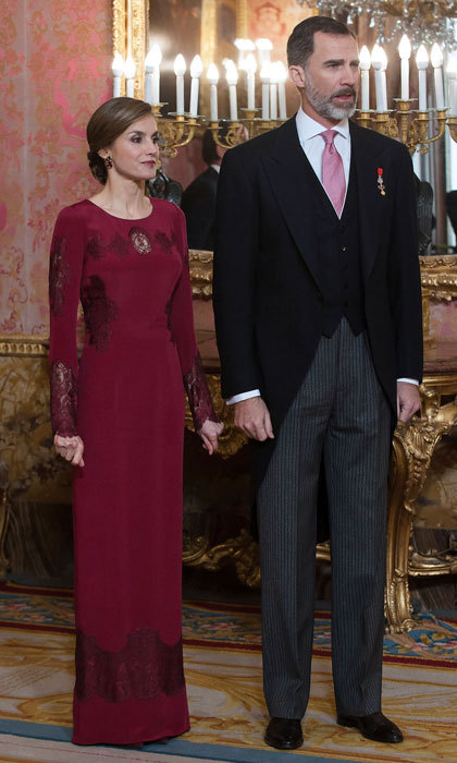 Queen Letizia opted for a full-length burgundy gown by Felipe Varela as she greeted ambassadors at the Royal Palace in Madrid.