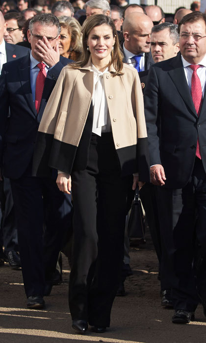 Queen Letizia of Spain wore her trusty black trousers, which she paired with a white pussy bow blouse and color block jacket, to the Agroexpo Agriculture International Fair in Don Benito, Spain. 