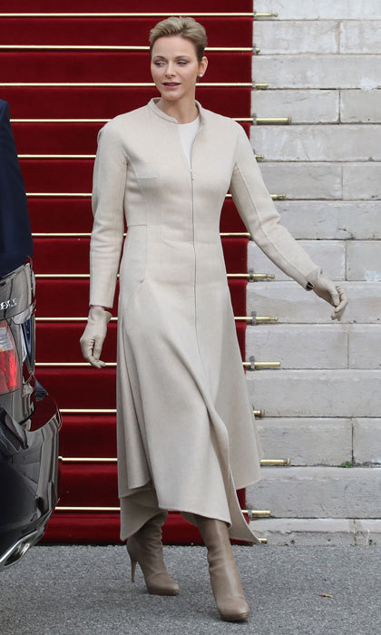 Princess Charlene of Monaco was the picture of elegance  leaving the Monaco Cathedral during the Sainte-Devote festivities wearing a sandstone-colored coat, which she paired with matching boots and gloves.