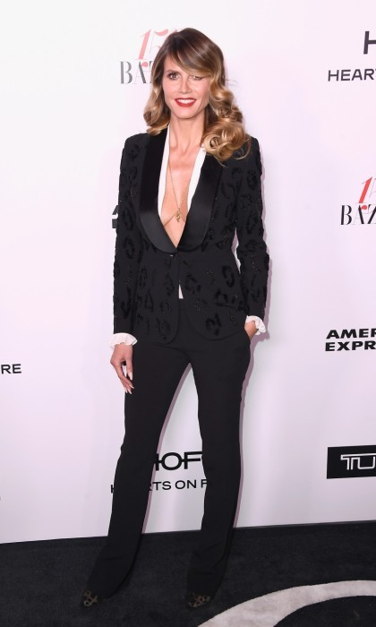 January 27: Heidi Klum stunned in a black suit at the Harper''s BAZAAR celebration. The 43-year-old model attended the star-studded event which was presented by TUMI in partnership with American Express, La Perla and Hearts On Fire.
