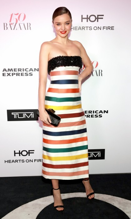 "January 27: Miranda Kerr rocked the Harper's BAZAAR carpet in a figure-hugging striped dress. The supermodel was among the beauties celebrated by the magazine as ""the best-dressed women in the world.""