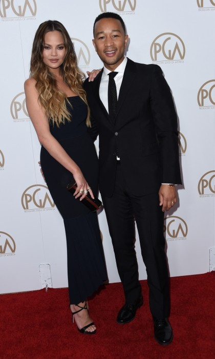 January 28: Chrissy Teigen and John Legend also showed some love on the PGA red carpet at The Beverly Hilton Hotel. John, star and executive producer of the PGA nominated film <i>La La Land</i>, planted a cute kiss on his wife's cheek. Chrissy wore a chic midnight blue dress.