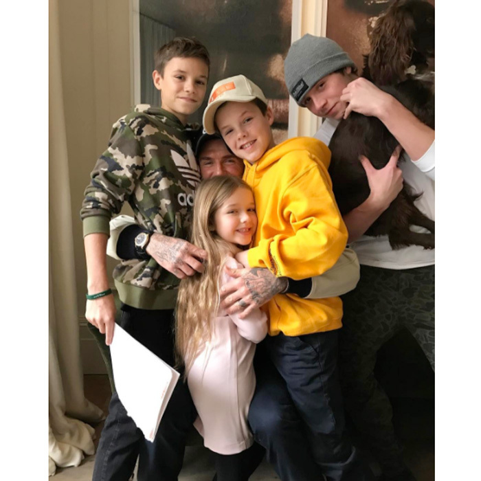 "Love fest! David Beckham embraced his four children, Romeo, Harper, Cruz and Brooklyn with a sweet hug. Alongside the photo, wife Victoria noted, ""I think they love him! We [heart emoji] you @davidbeckham X VB.""