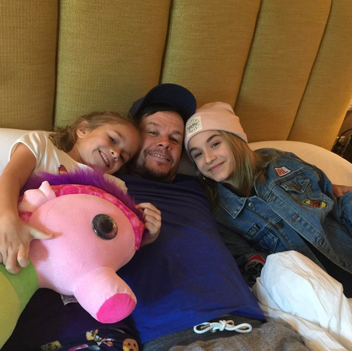 "Mark Wahlberg cuddled with his daughters Ella and Grace during a getaway. Attached to the sweet photo, the actor wrote, ""Took my girls on a daddy-daughter bonding weekend. #family.""