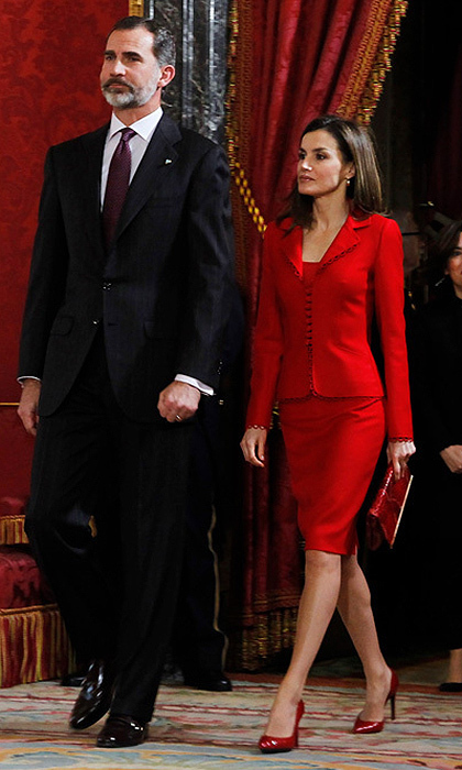 Queen Letizia of Spain wore a tailored red suit and red hot patent leather heels as she joined her husband at an event at the Royal Palace in Madrid.