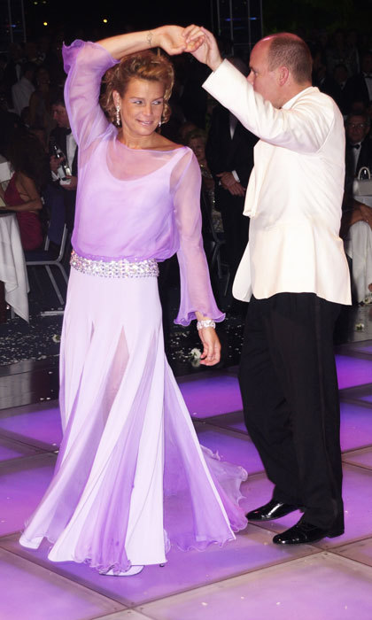 Stephanie showed off her dance moves twirling in a flowing white frock that featured slits and a purple overlay with her brother Prince Albert at the 2001 Red Cross Ball.