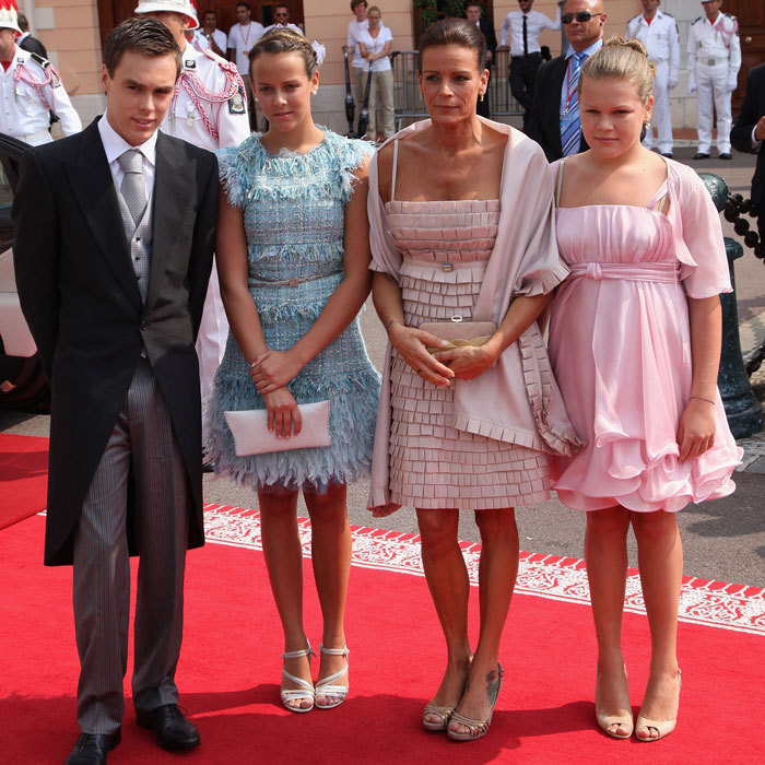 The Monaco royal (accompanied by her children Louis Ducruet, Pauline Ducruet and Camille Gotlieb) opted for a blush colored mini dress and matching wrap for her brother Prince Albert's 2011 wedding to Princess Charlene.  