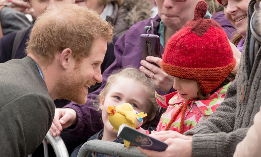 Harry certainly has a way with children! The Prince chatted with a young girl as he arrived to the Full Effect & Coach Core in Nottingham, England. 